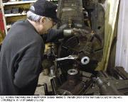 Volunteer operating a lathe